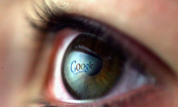 In this file photo the Google logo is reflected in the eye of a girl. (Chris Jackson/Getty Images)