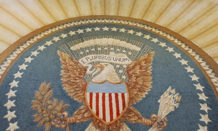 The Great Seal of the United States. Even though a government shutdown looms Oct. 1, the White House and a breakout group of eight Republican senators have been unable to agree on a bipartisan budget deal. (PAUL J. RICHARDS/AFP/Getty Images)