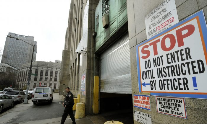 A New York City Police officer leaves the Manhattan Detention Complex in lower Manhattan January 28, 2010. (TIMOTHY A. CLARY/AFP/Getty Images)