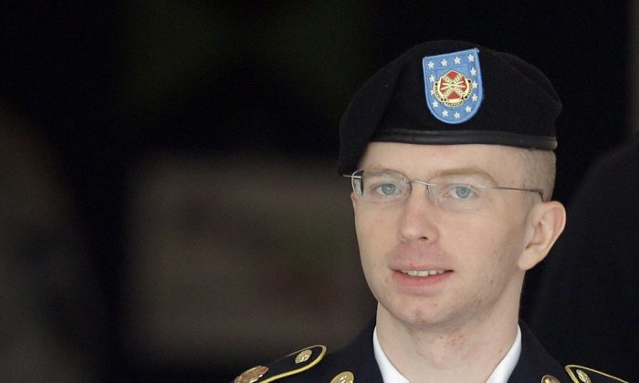 Army Pfc. Bradley Manning is escorted to a security vehicle outside a courthouse in Fort Meade, Md., after a hearing in his court martial on Aug. 16, 2013. (AP Photo/Patrick Semansky, File)