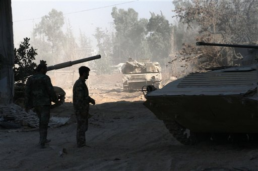 Syrian army soldiers are seen deployed in the Jobar neighborhood of Damascus, Syria, Saturday, Aug. 24, 2013. Jobar was the site of an alleged chemical weapons attack on August 21, 2013.(AP Photo)