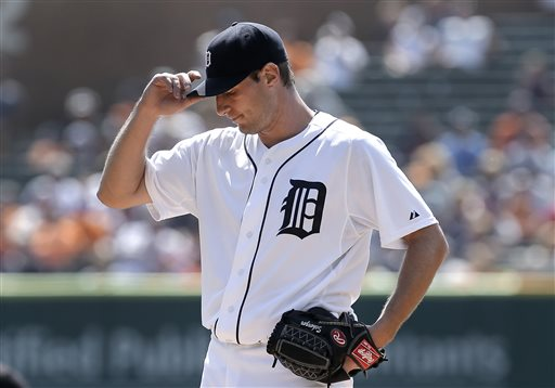 Detroit Tigers pitcher Max Scherzer reacts to giving up a two-run home run to Oakland Athletics' Jed Lowrie in the first inning of a baseball game in Detroit, Thursday, Aug. 29, 2013.  (AP Photo/Paul Sancya)