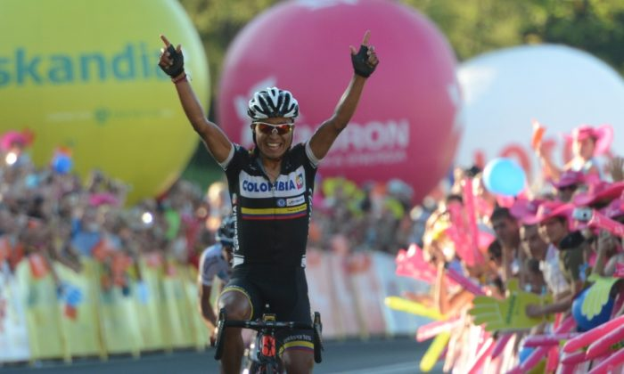 Darwin Atapuma celebrates as he crossed the finish line to take team Colombia's first World Tour win in Stage Six of the Tour de Pologne on Aug. 2, 2013. (colombiacyclingpro.com
