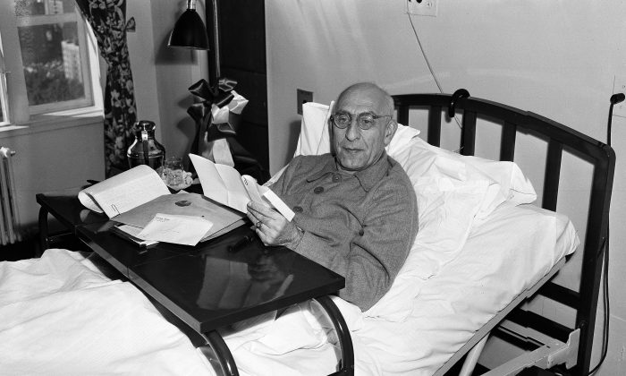 Premier Mohammad Mosaddeq of Iran lying in bed and reading letters and documents presented to him on October 12, 1951 in New York. (AP Photo)