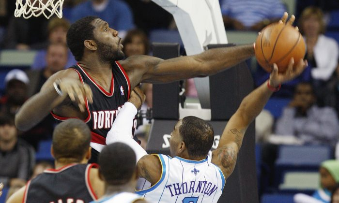 Portland Trailblazers center Greg Oden (52) blocks the shot of New Orleans Hornets guard Marcus Thornton (5) in the first half of an NBA basketball game in New Orleans, Friday, Nov. 13, 2009. Portland defeated the Hornets 86-78. (AP Photo/Bill Haber)