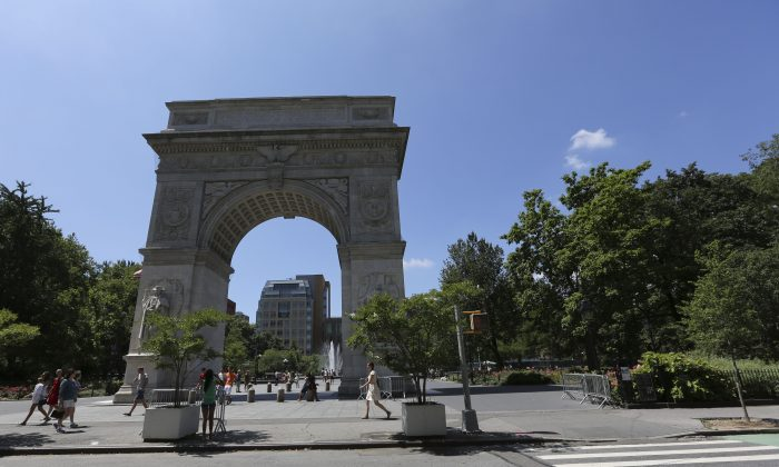 This Friday, July 5, 2013 photo shows the arch in Washington Square Park in New York. (AP Photo/Mary Altaffer)