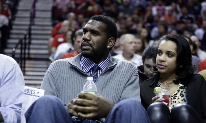 Former Portland Trail Blazers center Greg Oden watches from the crowd during the first quarter of an NBA basketball game between the Portland Trail Blazers and Memphis Grizzlies in Portland, Ore., Wednesday, April 3, 2013. (AP Photo/Don Ryan)