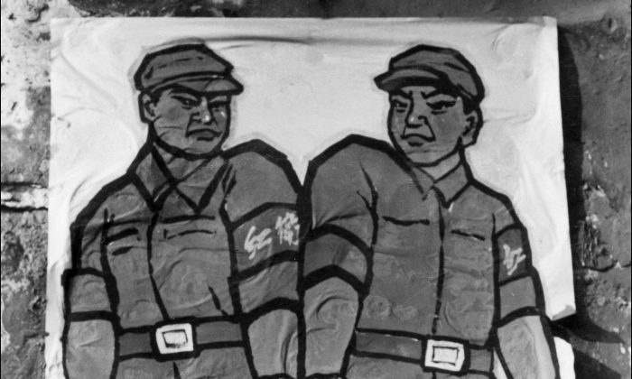 """A poster displayed in late 1966 in a Beijing street shows how to deal with a so-called 'enemy of the people' during the Great Proletarian Cultural Revolution. Zhang Hongbing took the Cultural Revolution's injunctions about """"enemies of the people"""" seriously and turned in his own mother, who was executed. He now seeks to use her death as a way to educate people about the cruelty of that time. (Jean Vincent/AFP/Getty Images)"""