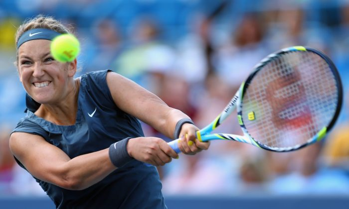 Victoria Azarenka of Belarus hits a backhand to Serena Williams in the Women's Singles final match during the Western & Southern Open on August 18, 2013 at Lindner Family Tennis Center in Cincinnati, Ohio. (Ronald Martinez/Getty Images)