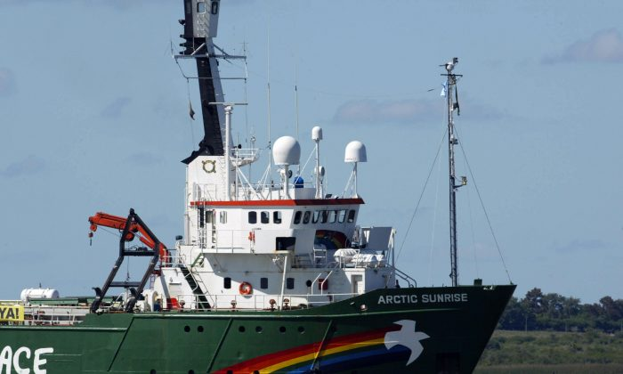 A file photo of the Greenpeace ship Arctic Sunrise as it sails by the Uruguay river in front of the Finland's Metsae Botnia group pulp mills plant, in Fray Bentos, Uruguay. The ship was boarded by Russian authorities during an Arctic oil drilling protest Monday, Aug. 26, 2013. (Miguel Rojo/AFP/Getty Images)