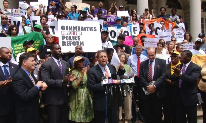 Brad Lander (C) City Council members and advocacy groups gathered on City Hall steps in Lower Manhattan on July 24. They publicly vowed to override Mayor Michael Bloomberg's veto of a set of bills related to the city's controversial stop-and-frisk policy. (NTD Television)
