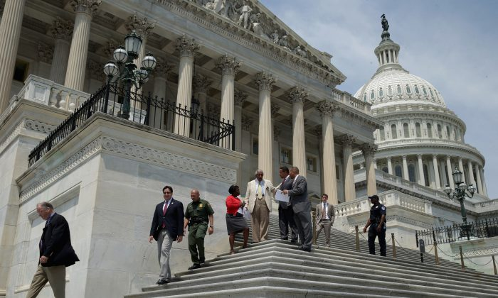 U.S. Rep. Charles Rangel (D-N.Y.) (C), and to hid left are U.S. Rep. Keith Ellison (D-Minn.) and U.S. Rep. Hakeem Jeffries (D-N.Y.) leave the U.S. Capitol as Congress begins its summer recess Aug. 2, 2013. Congress is headed into its summer recess without a deal on a federal budget, paving the way for a big showdown between Republicans and Democrats and a possible government shutdown in September. (Chip Somodevilla/Getty Images)