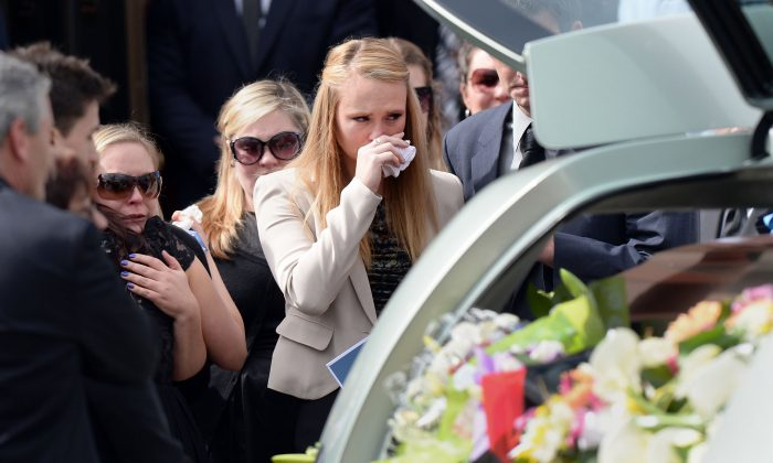 Girlfriend Sarah Harper (center R) joins family members of Australian baseball player Chris Lane, who was killed in the small Oklahoma town of Duncan in the US, as they leave St Therese's Parish after attending Lane's funeral in Melbourne on Aug. 28, 2013. (Mal Fairclough/AFP/Getty Images)