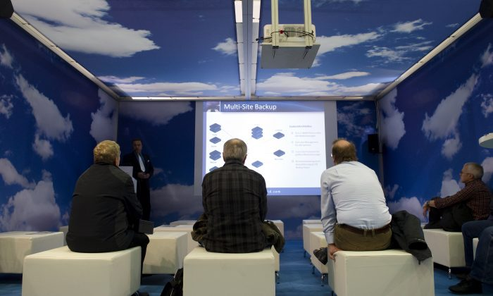 """Visitors listen to a speech about """"Cloud computing"""" and backups at the CeBIT, the world's biggest IT fair, on March 3, 2011 in Hanover, central Germany. (Johannes Eisele/AFP/Getty Images)"""