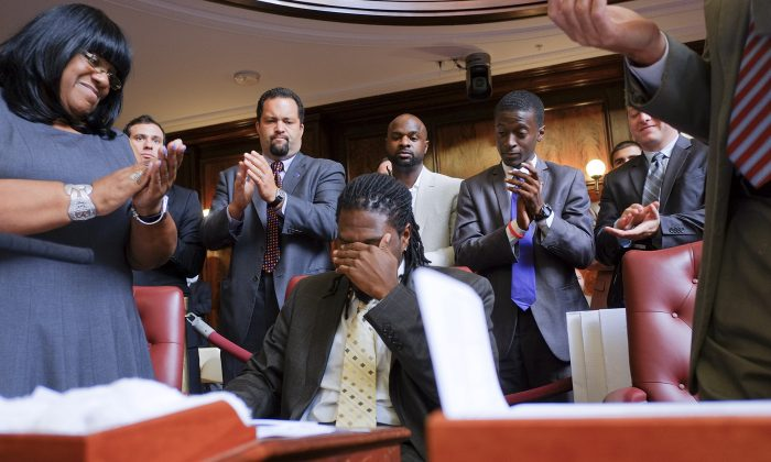 Council Member Jumaane Williams tears up as he casts his vote to pass the Community Safety Act at City Hall on August 22, 2013 in New York City. (William Alatriste/New York City Council)