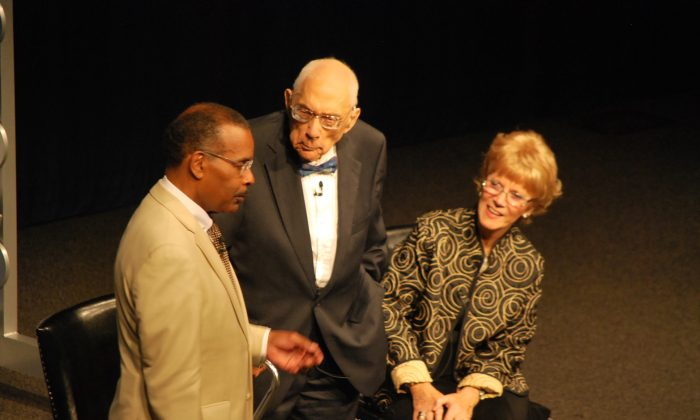 Simeon Booker (Center), joined by his wife, shares what it was like to be a journalist during the Civil Rights movement in the early 1960s with Joe Madison, Sirius XM satellite radio host and civil and human rights activist, at the Newseum in Washington, D.C., on Aug. 22, 2013. (Ron Dory/Epoch Times)