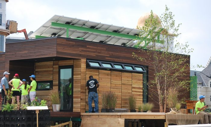 """The Harvest Home, solar powered and designed around the theme of the """"harvest"""" was completed by American University, Catholic University and George Washington University students. The home will compete in the Department of Energy Solar Decathlon in Irvine, Calif., Oct. 3-13. ( Photo/ Ron Dory, Epoch Times)"""