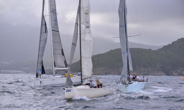 Sports Boat 'Merlin' and IRC competitors 'Signal 8' (right) and 'Lighthorse' (left) set off upwind from the Leeward Mark during Race-10 of the Hebe Haven Summer Saturday Series on Saturday Aug 3, 2013. 'Merlin' (064) the Series leader came second to 'Fly By Wire' in this race, while 'Signal 8' had double firsts (of line honours and on calculated time) in both Race-9 and Race 10. (Bill Cox/Epoch Times)