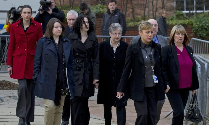 Families of Dale Cregan's victims attend Preston Crown Court on the first day of Cregan's trial in Preston, England, on Feb. 7, 2013. (AP Photo/Jon Super)