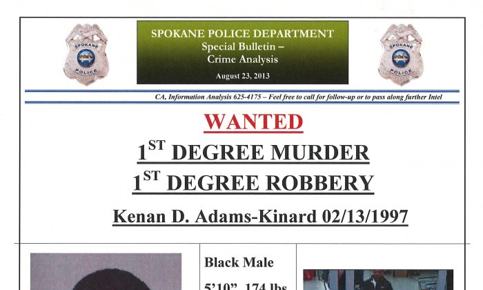 This image provided by the Spokane, Wash., Police Department shows a wanted poster for Kenan Adams-Kinard, 16, who was sought by police in connection with the beating death of an 88-year-old World War II veteran outside an Eagles lodge in Spokane Wednesday, Aug. 21, 2013. The teen was reportedly arrested Monday, Aug. 26, ending the hunt. (AP Photo/Spokane Police)
