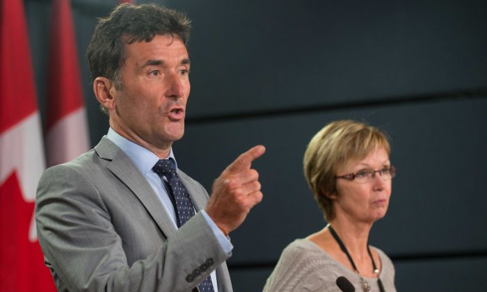 NDP foreign affairs critic Paul Dewar and party whip Nycole Turmel criticized the government over its handling of the Senate expense scandal Wednesday. Fresh findings against Senator Pamela Wallin have embarrassed the government. (Matthew Little/Epoch Times)