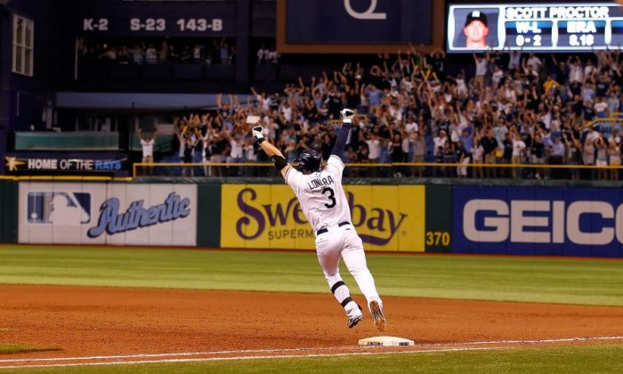 Evan Longoria of Tampa Bay rounds the bases after his bottom of the 12th-inning walk off home run against New York on Sept. 28, 2011, that put the Rays into the playoffs. (J. Meric/Getty Images)