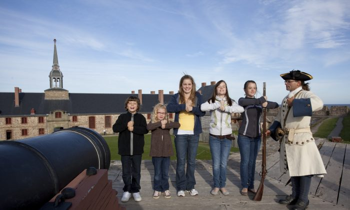 Children participate in a musket drill at the historic Louisbourg fortress. Celebrations are in full swing for Louisbourg 300, the 300th anniversary of the town's founding. Louisbourg was a hotspot of commerce and culture, trade and conquest in the 18th century. (Courtesy Parks Canada)
