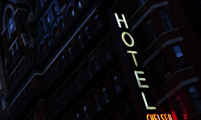 A view of the neon sign adorning the front facade of the Chelsea Hotel in New York. A new analysis of hotel fees found that 2013 will be a record year. (Emmanuel Dunand/AFP/Getty Images)