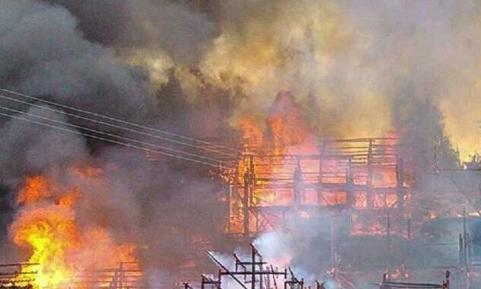Severe damage to traditional style wooden homes caused by a fire on Aug. 5. (Epoch Times Photo Archive)