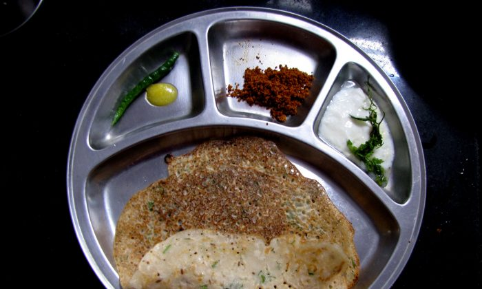Godhi Dose (Wheat Crepe) is cooked with different ingredients in different parts of India and is also known by different names. In South India it is often served with Chutni Pudi (grated coconut fried with spices) and Yogurt. (EPOCH TIMES)