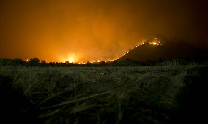 The Elk fire burns at night near Pine, Id., Sunday Aug. 11, 2013. (AP Photo/The Idaho Statesman, Kyle Green)