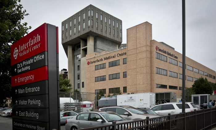 A view of Interfaith Medical Center along Atlantic Avenue on Thursday, July 25, 2013 in New York. Interfaith, which serves an overwhelming low-income population in Bedford-Stuyvesant, is the second Brooklyn hospital, along with Long Island College Hospital, facing possible closure and bankruptcy proceedings. (Bebeto Matthews/AP)
