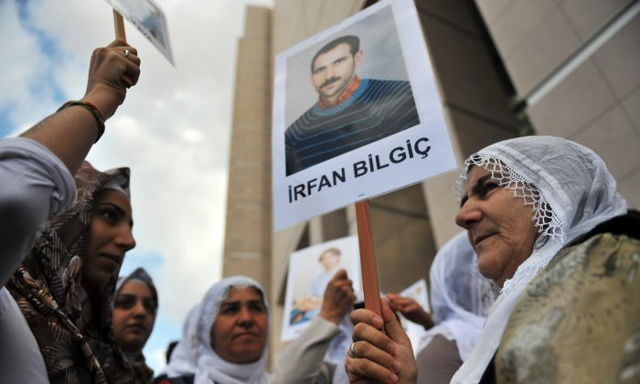 Kurdish women hold pictures of jailed journalists in Istanbul on Sept. 10, 2012. (Bulent Kilic/AFP/GettyImages)