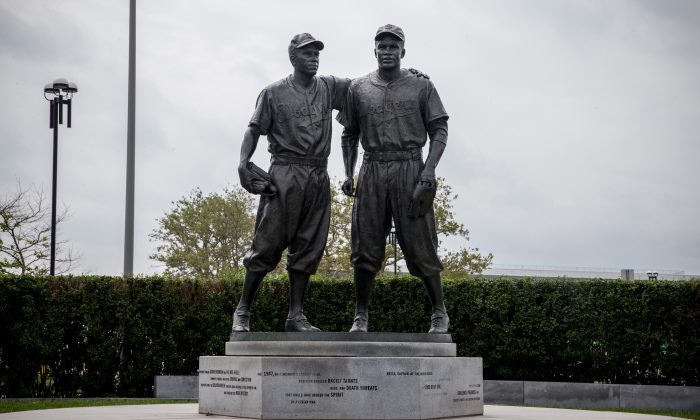 A statue of Pee Wee Reese (L) and Jackie Robinson after being cleaned of racist graffiti. The statue, which was unveiled in 2005, was recently defaced with racist graffiti and the city recently finished restoring the statue using sandblasting and power washing to remove it. (Andrew Burton/Getty Images)