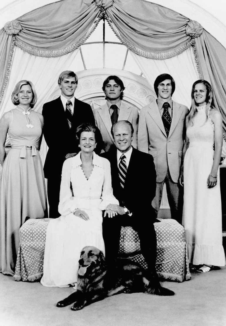 President Gerald Ford and First Lady Betty Ford pose with family members and their dog, a Golden Retriever named Liberty, at the White House in 1975. (AP Photo)