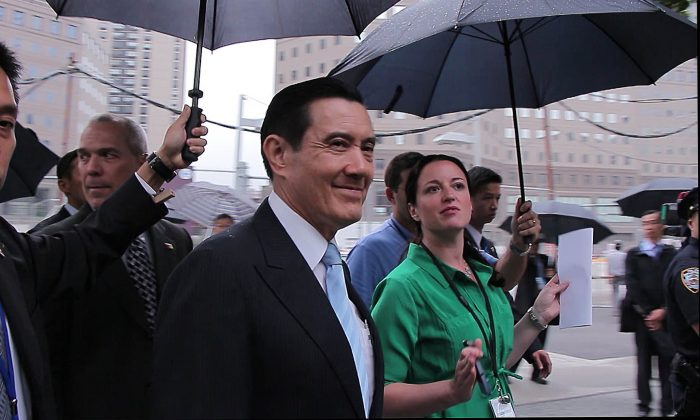 President of the Republic of China, Ma Ying-jeou, visits the 9/11 Memorial in New York Aug. 12 as part of a 12-day tour of the United States, the Caribbean, and Paraguay. (Gary Du/Epoch Times)