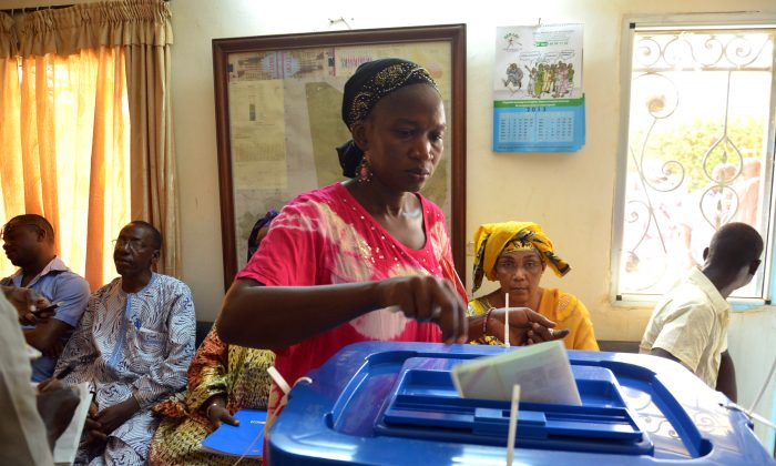 A Malian woman living in Burkina Faso casts her vote for the Malian presidential election at the Malian embassy in Burkina Faso on July 28, 2013 in Ouagadougou. (Ahmed Ouoba/AFP/Getty Images)