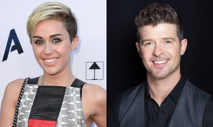 This combination of August 2013 file photos shows Miley Cyrus, left, in Los Angeles and Robin Thicke in New York. Cyrus and Thicke performed at the MTV Video Music Awards on Aug. 25, 2013. (Jordan Strauss, Victoria Will/Invision/AP)