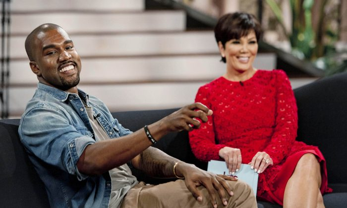 "Singer Kanye West(L) with host Kris Jenner during a taping of her talk show ""Kris,"" in Culver City, Calif., Aug. 19, 2013. West proclaims his love for Jenner's daughter, Kim Kardashian, and their daughter North in the interview airing Aug. 23. (AP Photo/20th Century Television, Barry J. Holmes)"