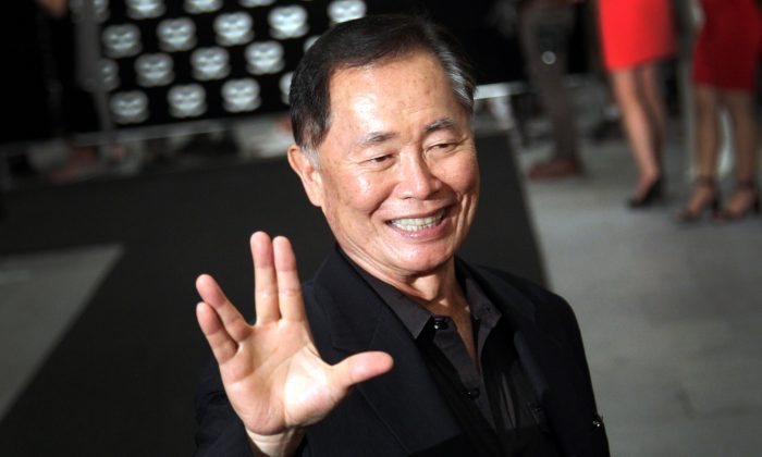 "Actor George Takei gesturing with a hand greeting made popular by the TV series ""Star Trek"" at the Marina Bay Sands hotel in Singapore for the inaugural Social Star Awards, May 23, 2013. (AP Photo/Wong Maye-E)"