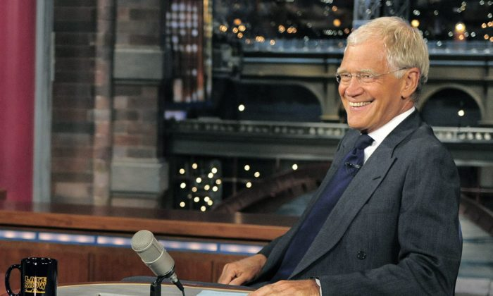 "Host David Letterman smiles on the set of the ""Late Show with David Letterman,""on July 16, 2013. (AP Photo/CBS, John Paul Filo)"