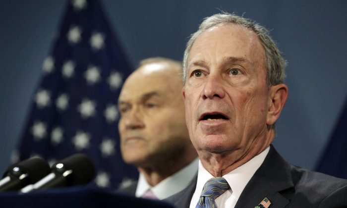 New York Mayor Michael Bloomberg (R), accompanied by Police Commissioner Raymond Kelly, addresses a news conference in the Blue Room of New York's City Hall, April 16, 2013.  (Richard Drew/AP Photo)