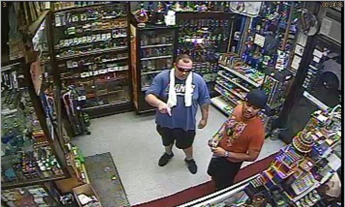 A photo of the two men who robbed a smoke store on W 4th Street last month, taken from the store's surveillance camera. (Photo credit NYPD, @NYPDnews)