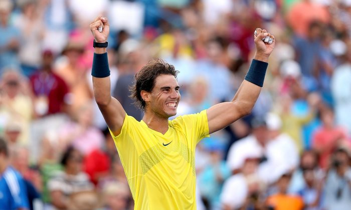 Rafael Nadal of Spain celebrates his win over Tomas Berdych of Czech Republic during the semifinals of the Western & Southern Open on August 17, 2013 at Lindner Family Tennis Center in Cincinnati, Ohio. (Matthew Stockman/Getty Images)