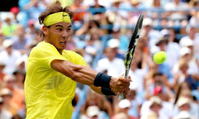 Rafael Nadal of Spain returns a shot to John Isner during the final of the Western & Southern Open on August 18, 2013 at Lindner Family Tennis Center in Cincinnati, Ohio. (Matthew Stockman/Getty Images)