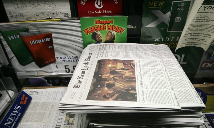 A file photo of copies of The New York Times are sold in New York. The New York Times website went down Tuesday, Aug. 27, 2013, for the second time in two weeks. (AP Photo/Mark Lennihan, File)