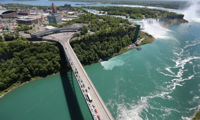 The Rainbow Bridge straddles the U.S.-Canada border on the Niagara River, which drains Lake Erie into Lake Ontario. It is all part of the New York Canal System undergoing its annual inspection. (John Moore/Getty Images)
