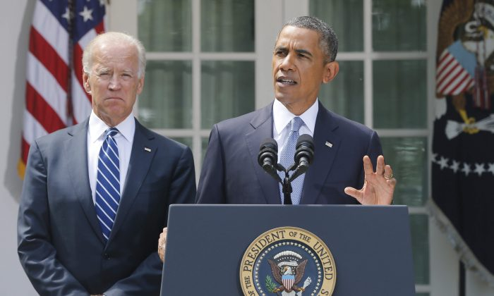 President Barack Obama stands with Vice President Joe Biden as he makes a statement about Syria in the Rose Garden at the White House in Washington, Saturday, Aug. 31, 2013. (AP Photo/Charles Dharapak)