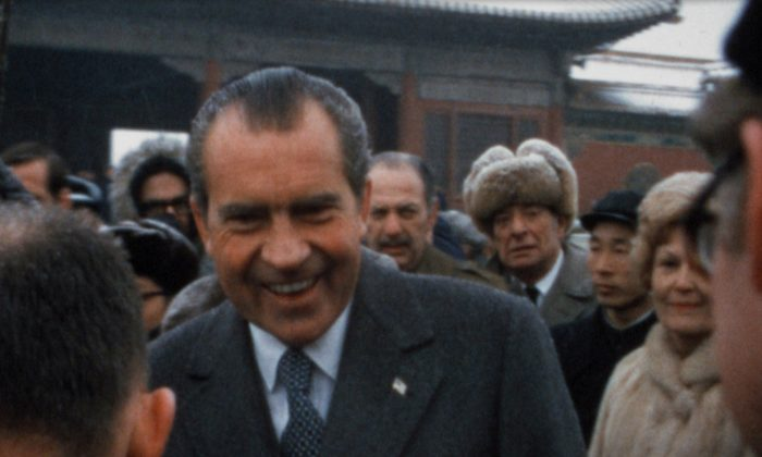 "President and Mrs. Nixon mingle with the locals in China while the American press looks on. Nixon dubbed this trip ""the week that changed the world."" February 1972. (Super 8 film still, Dipper Films/ Courtesy of Cinedigm)"