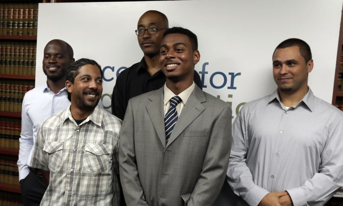 Nicholas Peart, Lilat Clarkson, Leroy Downes, Devin Almonar and David Ourlicht, (L-R), plaintiffs in the stop and frisk case, pose for a photo after a news conference at the Center for Constitutional Rights, in New York, Monday, Aug. 12, 2013. U.S. District Judge Shira Scheindlin ruled that the New York Police Department deliberately violated the civil rights of tens of thousands of New Yorkers with its contentious stop-and-frisk policy, and an independent monitor is needed to oversee major changes. (Richard Drew/AP Photo)